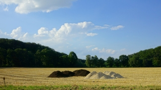 erkrath mounds of sand and dirt in a stubble field